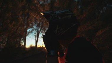 Mountain biker taking off his helmet — Stock Video