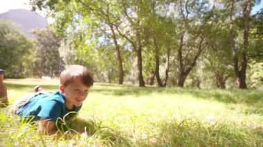 Laughing boy in grass — Stock Video