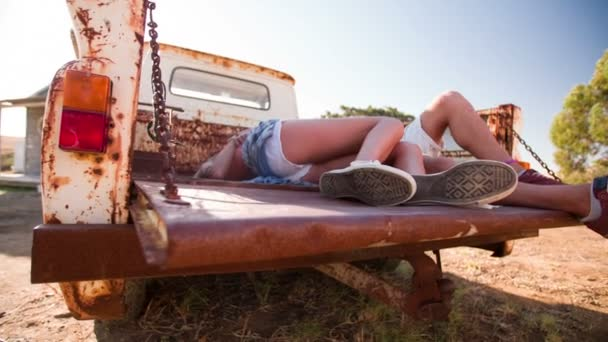 Couple kissing in back of vintage truck — Vidéo