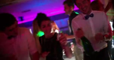 Friends drinking champagne in night club — Stock Video