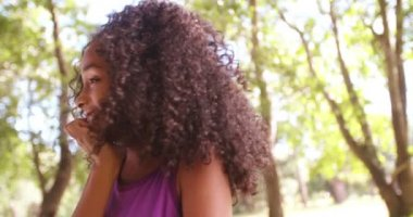 Afro girl smiling innocently in a park — Stock Video