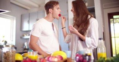 Woman feeding her boyfriend a strawberry — Stock Video