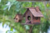 Two wooden bird houses, one in focus, one out. — Stock Photo