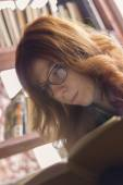 Hipster girl reading a book — Foto de Stock