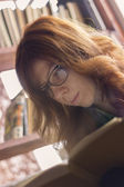 Hipster girl reading a book — Foto Stock