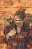 Hipster girl playing with her cat — Stock Photo