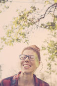 Hipster girl smiling happily — Stock Photo