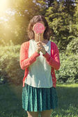 Cute hipster girl holding a big lollipop — Stock Photo