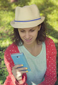 Hipster girl texting — Stock Photo
