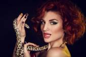 Portrait of Beautiful Woman in studio with dangerous snake — Foto Stock