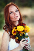 Beautiful redhair bride outdoors — Stock Photo
