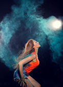 Girl with colored powder trailing behind her hair — Stock Photo
