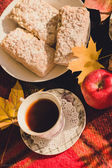 Autumn composition of yellow flowers, oatmeal cookies, apple, pu — Stock Photo
