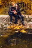 Happy young couple in love meeting on the autumn leaf — Stock Photo