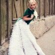 A woman like a princess in an vintage dress in fairy park — Stock Photo #65031075