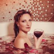 Young woman with red hair take bubble bath with candle. — Stock Photo #69825919