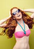 Beautiful bikini woman smiling on green background. — 图库照片