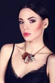 Beautiful woman with dark hair and evening makeup. Jewelry and Beauty. Fashion art photo — Stock Photo