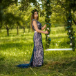 Girl with plums near the swing — Stock Photo #58094301