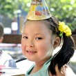 Young girl at a child's birthday party — Stok fotoğraf