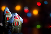 Christmas light house on a background of colorful bokeh — Stock Photo