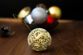Christmas balls and cones on a wooden background — Stockfoto