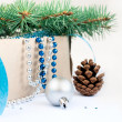 Box with Christmas toys, blue and silver beads, blue ribbon and — Stock Photo #59772185