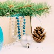 Box with Christmas toys, blue and silver beads, blue ribbon and — Stock Photo #59772273