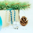 Box with Christmas toys, blue and silver beads, blue ribbon and — Stock Photo #59772805