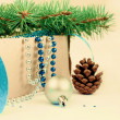 Box with Christmas toys, blue and silver beads, blue ribbon and — Stock Photo #59773209