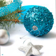 Branch of a Christmas tree and blue ball and ribbon — Stock Photo #59943635