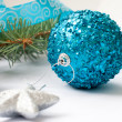 Branch of a Christmas tree and blue ball and ribbon — Stock Photo #59943643