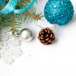 Branch of a Christmas tree and blue ball and ribbon — Stock Photo #59943761