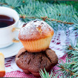 Pyramid of homemade muffins with cup of tea — Stock Photo #60248895