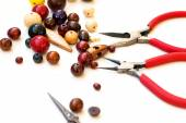 Wooden beads and tools for creating fashion jewelry in the manuf — Stock Photo