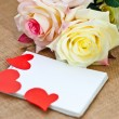 Romantic card with roses. notebook and hearts — Stock Photo #60989459