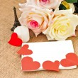 Romantic card with roses. notebook and hearts — Stock Photo #60993805