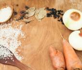 Rice, carrot, onion, spices, barberry on a table set for pilaf — Stock Photo