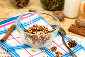 Bowl of granola oatmeal with walnuts and honey in a jar, a bottl — Stock Photo