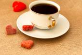Cup of coffee and sugar hearts — Stock Photo