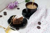 Piece of chocolate cake and a cup of coffee with milk — Stockfoto