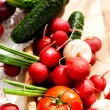Fresh vegetables - tomatoes, radishes, green onions, cucumbers — Stock Photo #70916529