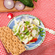 Spring salad with radishes, cucumber, cabbage and onion close-up — Stock Photo #72270093