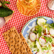 Spring salad with radishes, cucumber, cabbage and onion close-up — Stock Photo #72270505