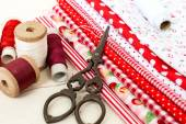 Colored fabric spools of thread and scissors for sewing — Stock Photo