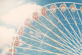 Ferris wheel against the blue sky toned photo — Stock Photo