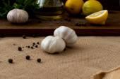 Slices of lemon, garlic cloves and parsley on white background — Stock Photo