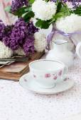 Bunch lilac flowers in a bowl — Stock Photo