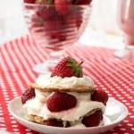Постер, плакат: Cake of waffles with strawberries and cream