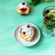 Cakes from cottage cheese with cranberry jam — Stock Photo #74131975